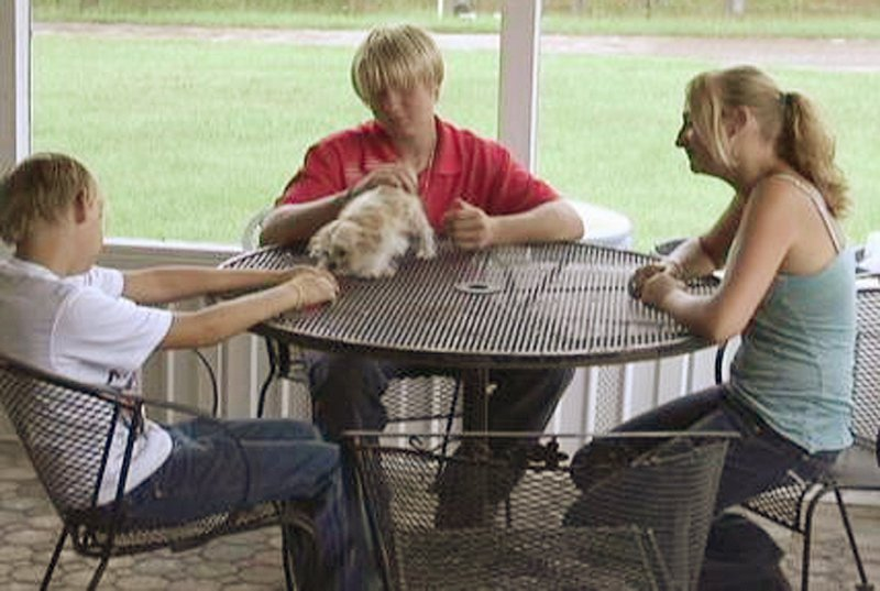 The kids who decided to fly to Nashville from Jacksonville, Fla., discuss their experience Friday. Kodie Brown, 11, left, friend Bobby Nolan III, 13, and Bridget Brown, 15, flew with money saved from baby-sitting, unbeknownst to their parents.