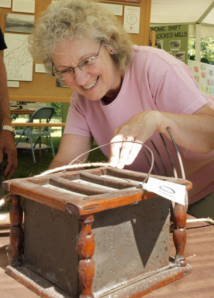 Faye Russell of Mason Township guesses about a historic item in the What's It Contest at the Summer Heritage Festival.