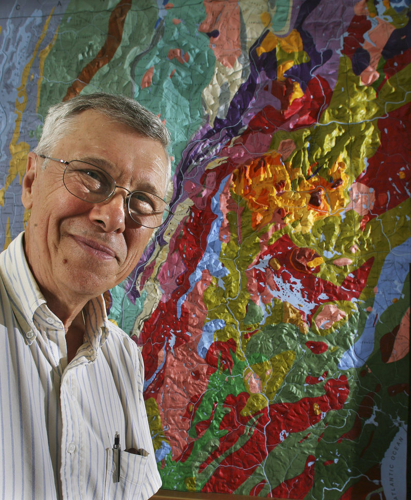 University of New Hampshire geology professor Wally Bothner poses in front of a relief map at the university in Durham. Bothner and a team of UNH students spent the last year repairing and repainting the 12- by 16-foot wood and plaster map created in the late 1800s by Charles Hitchcock, one of New Hampshire's first state geologists.