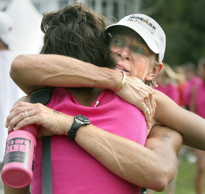 Anne Wilkinson of Falmouth receives a hug from friend Kelsey Abbott of Freeport.