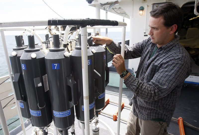 Survey technician Jim Burkitt adjusts bottles used to capture subsurface water samples Saturday before the device is deployed from the NOAA research vessel Henry B. Bigelow off Louisiana. The vessel is operating near the site of the Deepwater Horizon oil wellhead to collect water samples for analysis onshore as well as monitor oil and gas seepage on the seafloor. Scientists have provided different estimates on how much oil from the Gulf spill remains in the ocean.