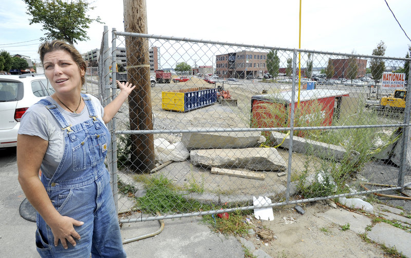 Nancy Pugh, co-owner of Hugo's restaurant on Middle Street, is unhappy that a two-story parking garage will be built on the former Jordan's Meats site near her business.