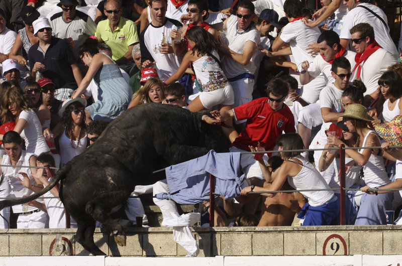 An 1,100-pound bull leaps into the stands during a bullfight in Tafalla, northern Spain, in this photo from Wednesday. Up to 40 were injured and three were hospitalized when the bull cleared two barriers before leaping into the stands. The bull was captured and later killed.