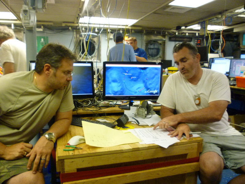 Rich Camilli, left, and Chris Reddy of the Woods Hole Oceanographic Institution discuss oil plume measurements in June aboard the research vessel Endeavor in the Gulf of Mexico. Camilli, chief author of a study released Thursday, said the plume is at least 22 miles long and probably even larger, but scientists had to stop measuring it because of Hurricane Alex.