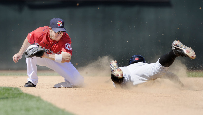 Sea Dogs second baseman Nate Spears prepares to swipe the tag on Chase d'Arnaud of the Altoona Curve and snuff out a steal attempt Thursday at Hadlock Field. Portland ended a three-game losing streak with a 9-8 victory.