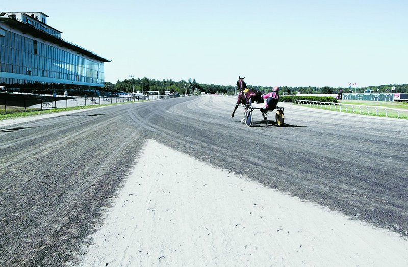 Mark Harris, a horse trainer and owner, jogs his horse, Fast Guy, before the start of live racing at the Scarborough Downs racetrack on Thursday. Scarborough voters have twice rejected proposals that would have allowed slot machines at the harness-racing facility.