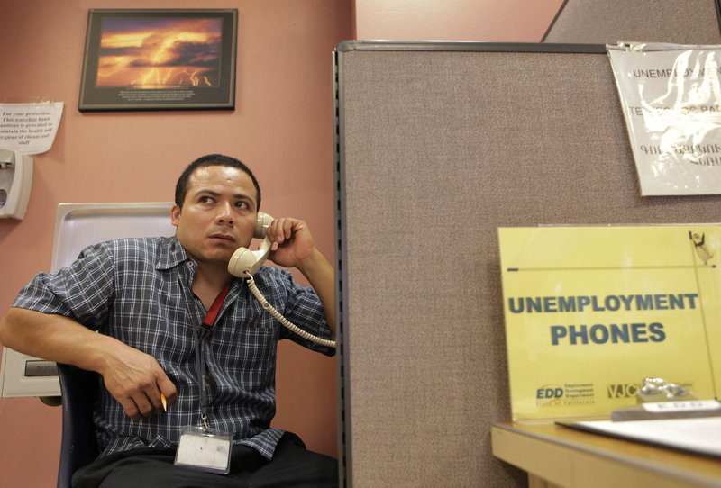 Unemployed mechanic Jaime Rivas calls to request an extension on his jobless benefits Thursday in Glendale, Calif., amid fears that employers are cutting jobs again.
