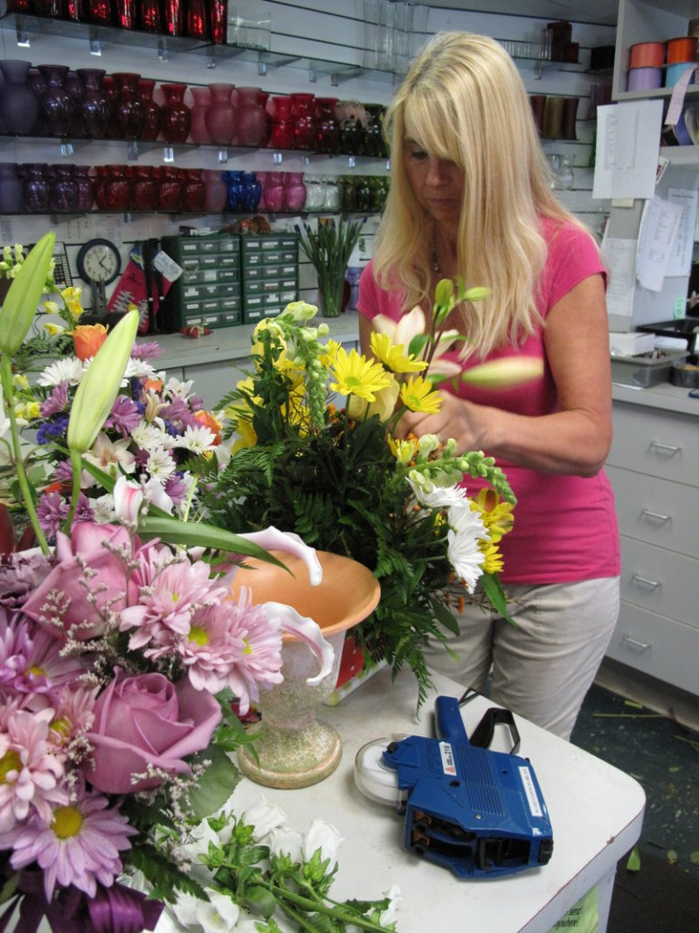 """""""We usually have beach weddings all summer,"""" says Susan Mitchell, a florist near Pensacola Beach, Fla., who believes her business was hurt by the oil spill. She worries it will be difficult to prove that when she tries to recoup lost income from BP."""