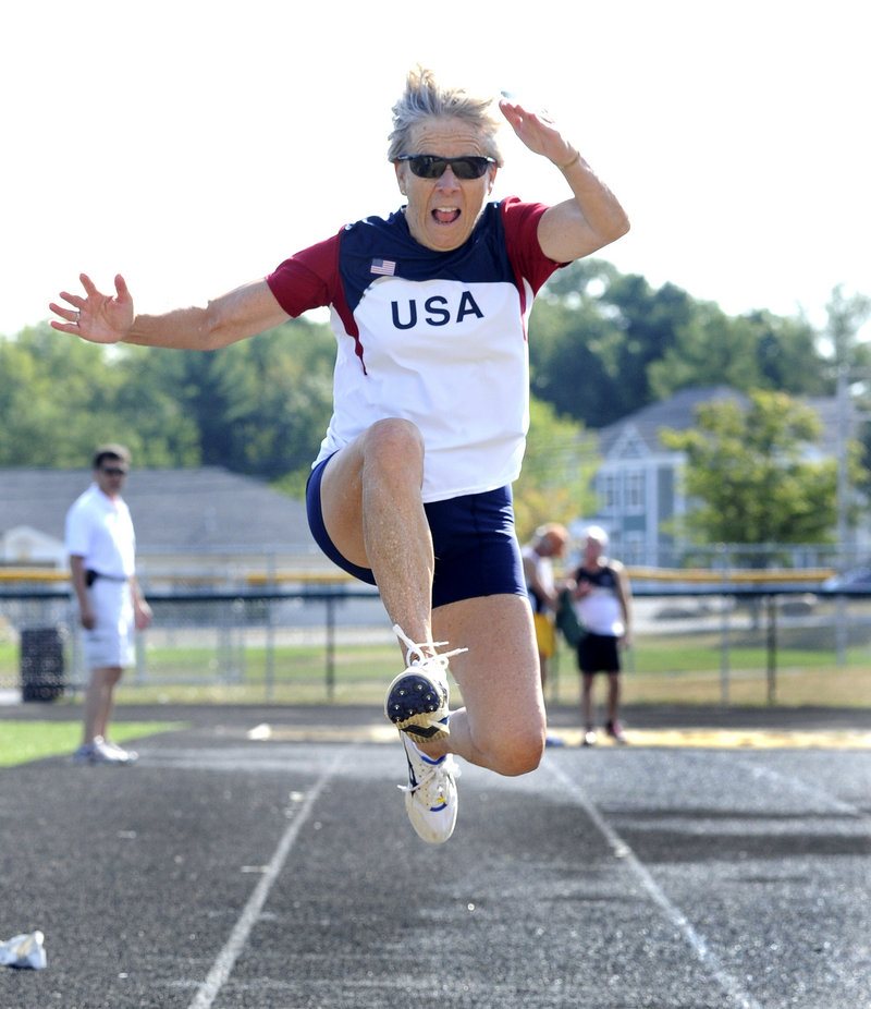 Barbara Jordan, 74, of South Burlington, Vt., competes in the long jump, finishing second in her age group with a jump of 8 feet, 9 1/2 inches at Scarborough High.