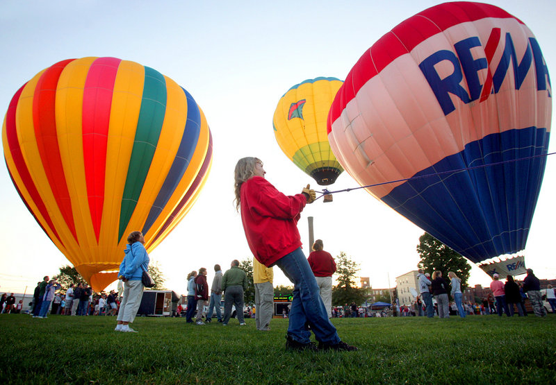 Bonnie Ingrassia pulls a line as she helps launch her daughter's balloon, Wandering Winds, on Saturday morning.