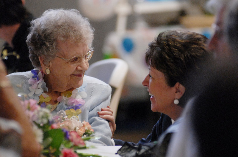 Cora Brown talks with U.S. Sen. Susan Collins, R-Maine, during Brown's surprise 100th birthday party in Portland on Saturday.Shawn Patrick Ouellette/Staff Photographer