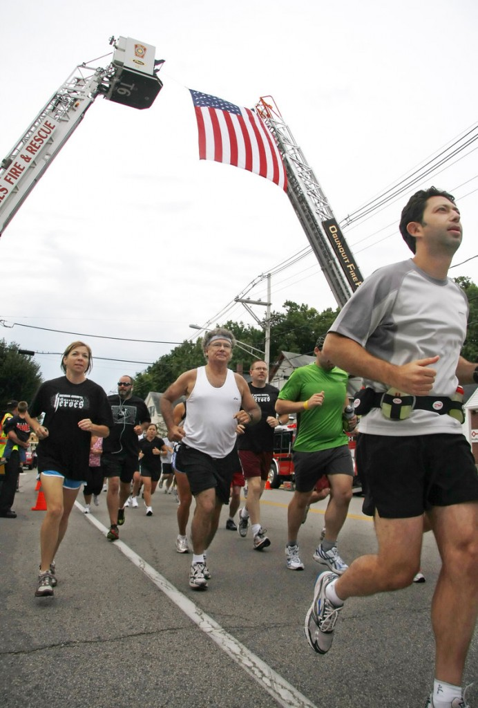 Participants begin the Run for the Fallen Maine, a 65-kilometer trek, in Ogunquit on Sunday.