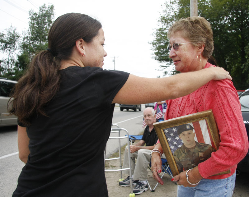 runner Lisa Randazzo of Berwick stops to introduce herself to Sarah Allard of North Berwick who holds a picture of her grandson Army Sgt. Jeremiah Holmes, with whom Randazzo graduated high school.