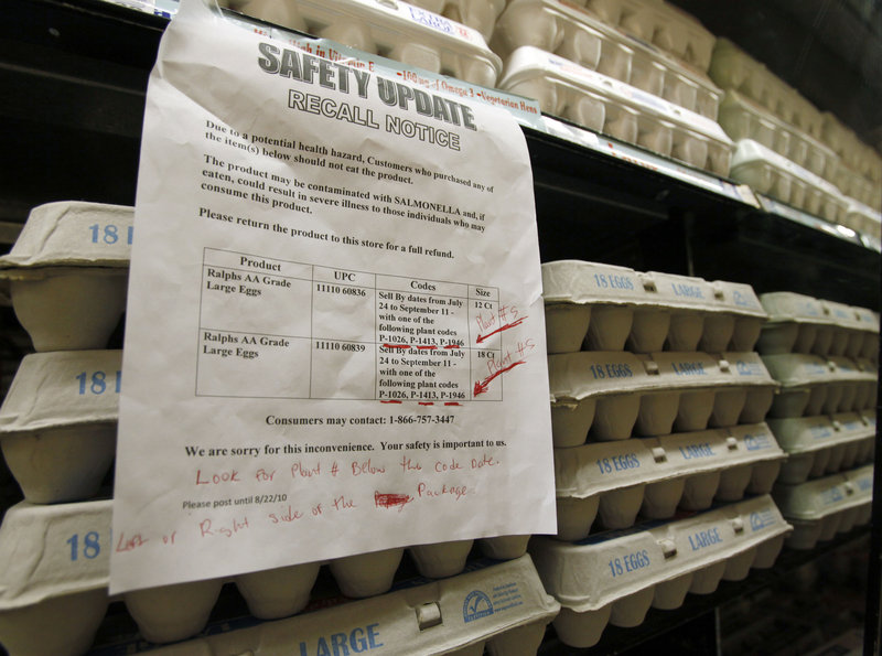 A sign at a Los Angeles supermarket warns customers of the recall of certain lots of eggs. One of the farms tied to the recall, DeCoster Egg Farms, paid a $2 million fine in Maine in 1997.