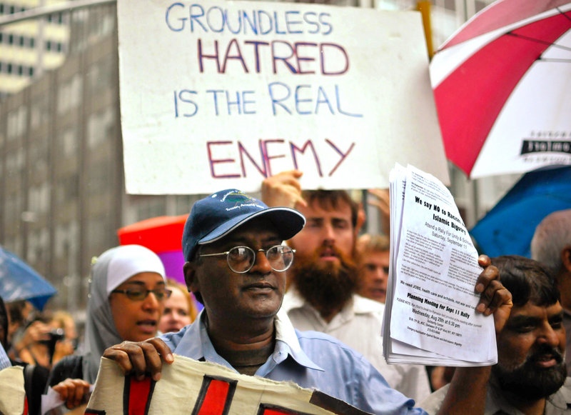 Supporters of the proposed Islamic center near ground zero make their feelings known in lower Manhattan on Sunday.