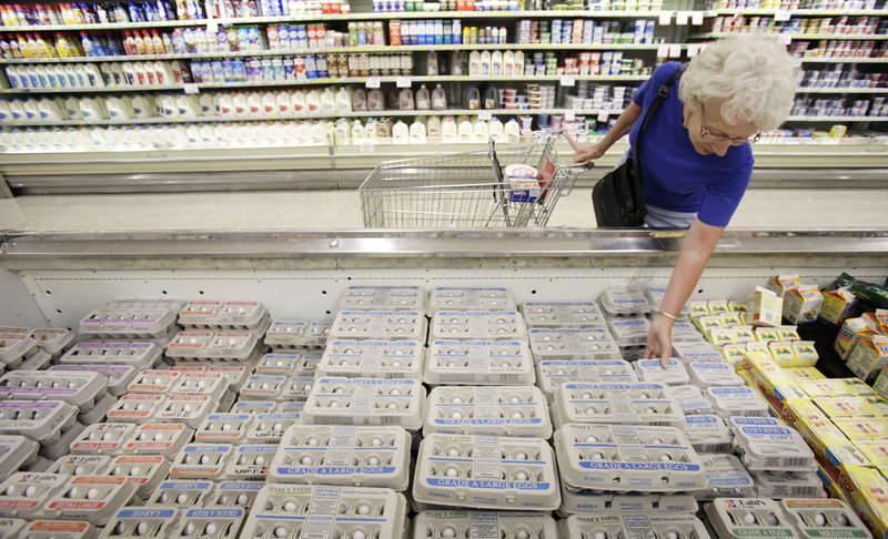 Janet Weaver of Des Moines, Iowa, shops for eggs Monday at a Dahl's grocery store in Des Moines. A sign on the cooler said the eggs were not affected by the recall. Two Iowa farms have recalled more than a half-billion eggs linked to as many as 1,300 cases of salmonella poisoning.