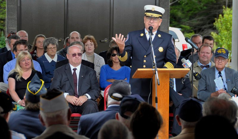 Sanford Fire Chief Raymond Parent addresses a crowd of about 500 at the dedication of the Southern Maine Memorial Veterans Cemetery in Sanford on Tuesday. He said the first military funeral there will be for former state Rep. Roger Landry.