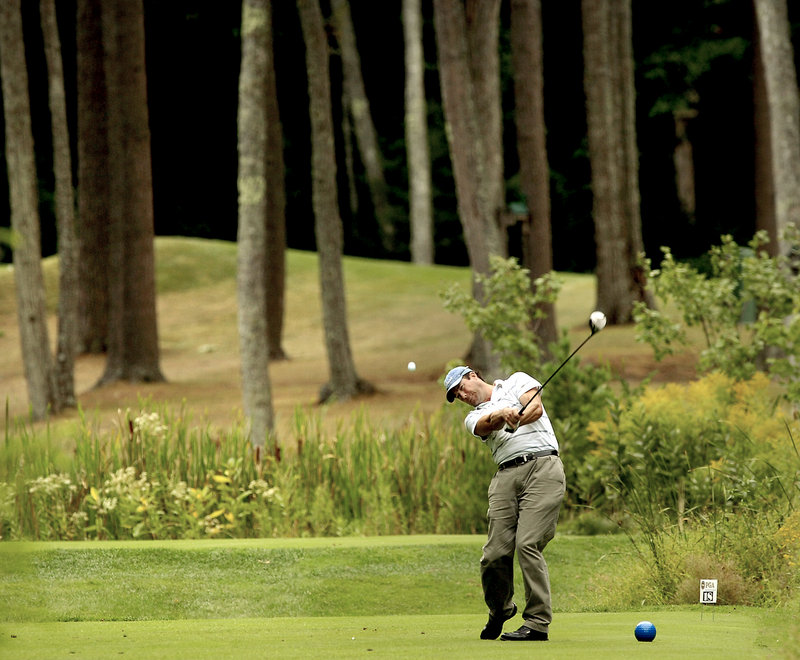 Jay Pollini, head professional at Farmington (N.H.) Country Club, hits his drive on the final hole Tuesday during the first round of the NEPGA Championship at The Woodlands Club in Falmouth. Golfers also are playing at Portland Country Club.