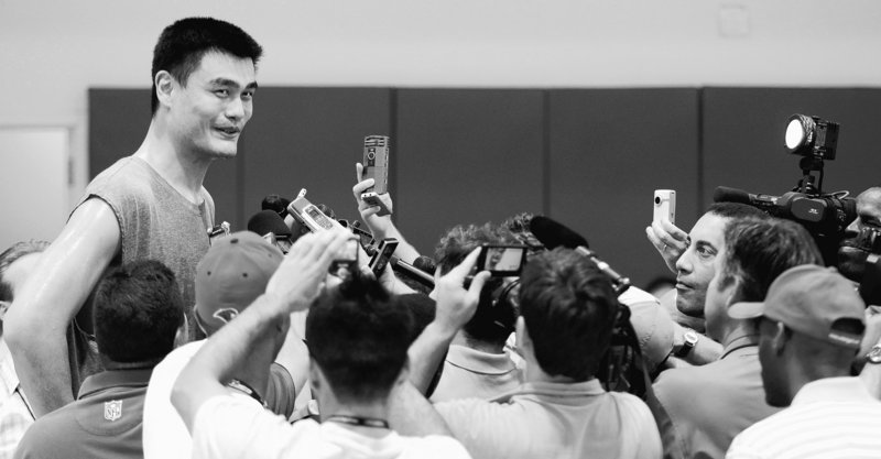 Yao Ming, the 7-foot-6 center, talks with reporters after a workout Tuesday. A stress fracture in his foot has healed and he hopes to play a full season with Houston.