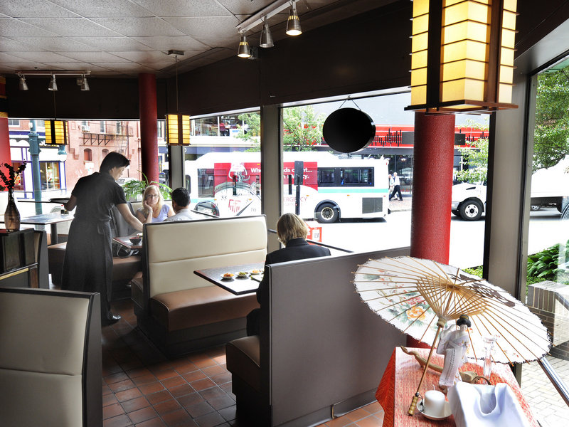 Server Catherine Burrill waits on a table at Soju, which serves inexpensive Korean and Japanese specialties.