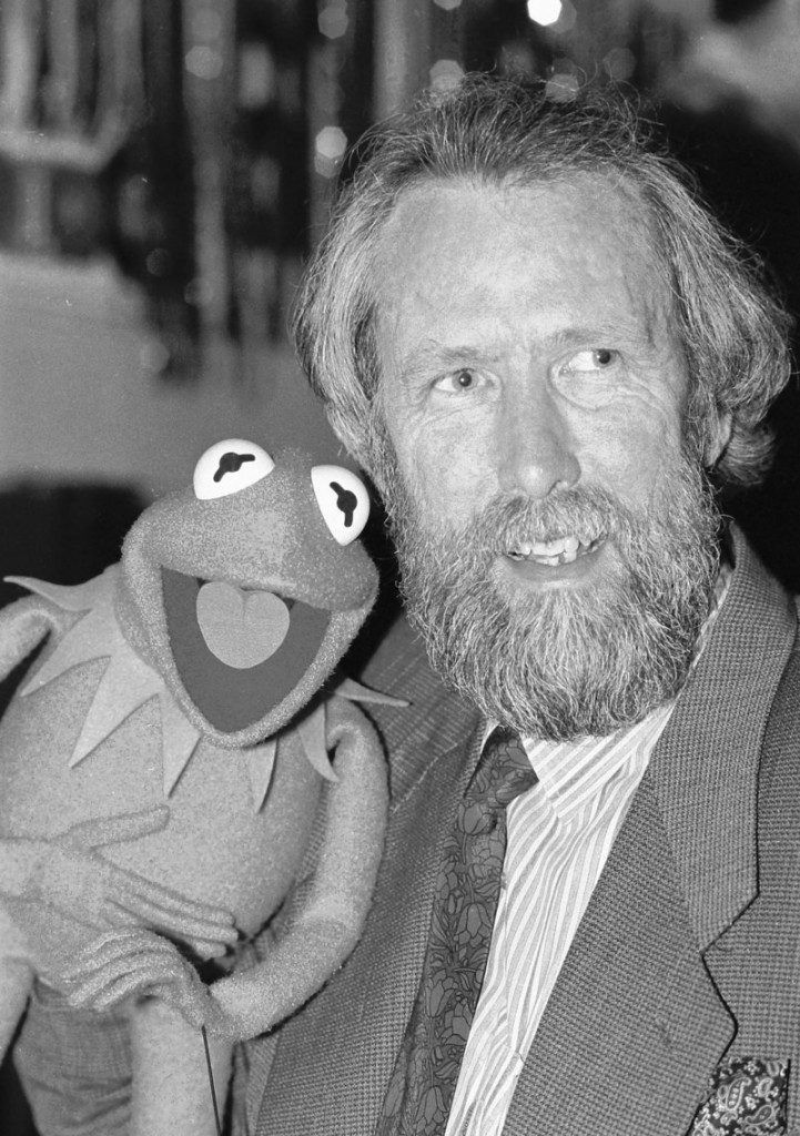 Jim Henson, creator of the Muppets, poses with Kermit the Frog in this 1988 photo. The first Kermit was more lizard-like and a duller green.