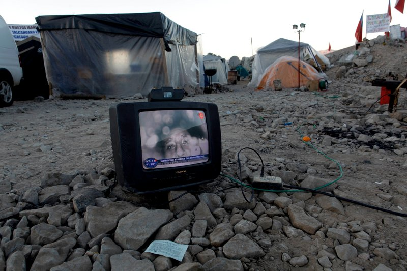An image of Florencio Avalos, one of the 33 miners trapped in the San Jose collapsed mine, is seen on a TV set near the mine in Copiapo, Chile, on Thursday. The miners, who have been trapped since the shaft they were working in collapsed on Aug. 5, were reached Sunday via a small hole.