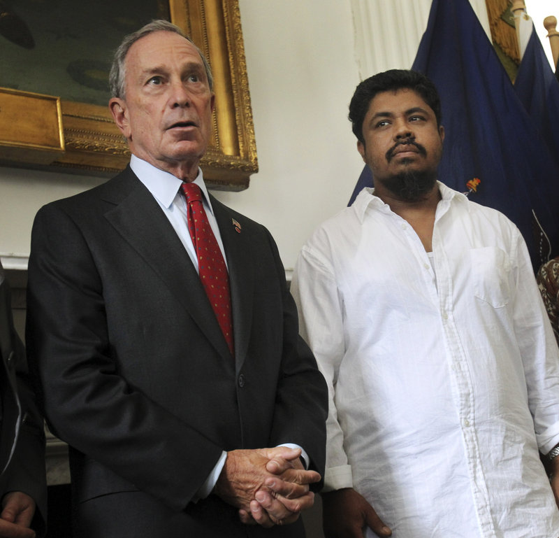 """New York City Mayor Michael Bloomberg appears with taxi driver Ahmed Sharif on Thursday. Sharif, who was attacked Wednesday, said, """"Of course it was for my religion."""""""