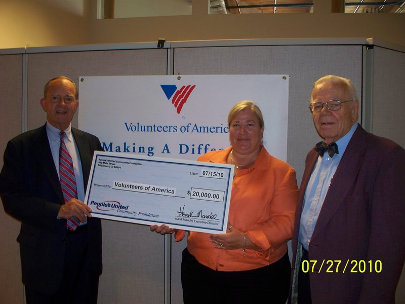 Samuel Ladd of People's United Bank, left, with June Koegel of Volunteers of America Northern New England, and Bill Inderstrodt, retired minister and affordable housing developer.