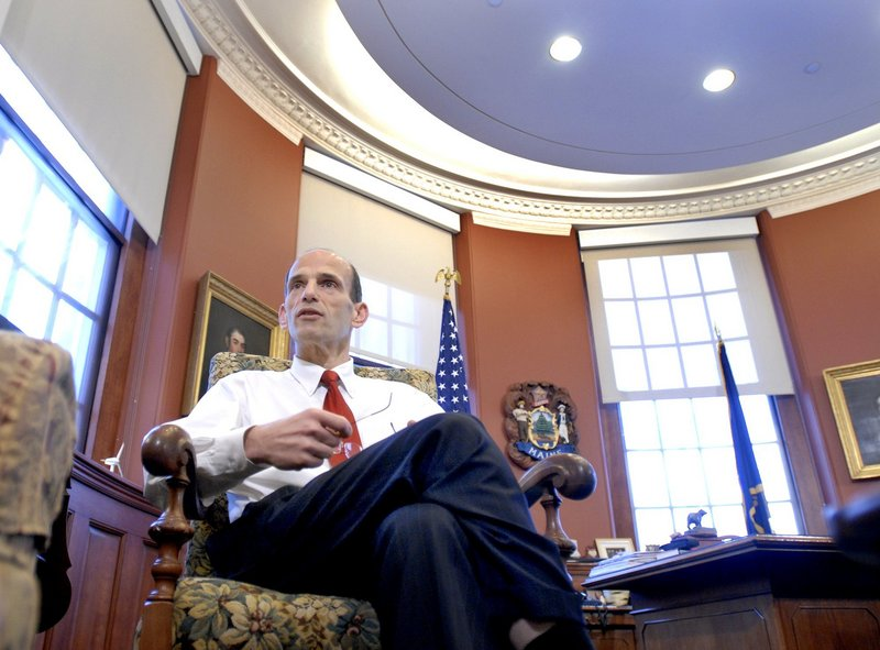 Gov. John Baldacci sits in his office in the State House, a chair that others are competing to fill next January.