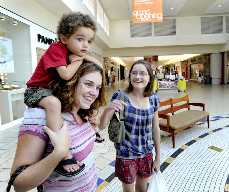 Maine Mall shoppers Candace Davis of Westbrook, her son Dominic Diego Davis, 3, and daughter Caitlin Morgan, 12, shop for school items Friday at the Maine Mall in South Portland.