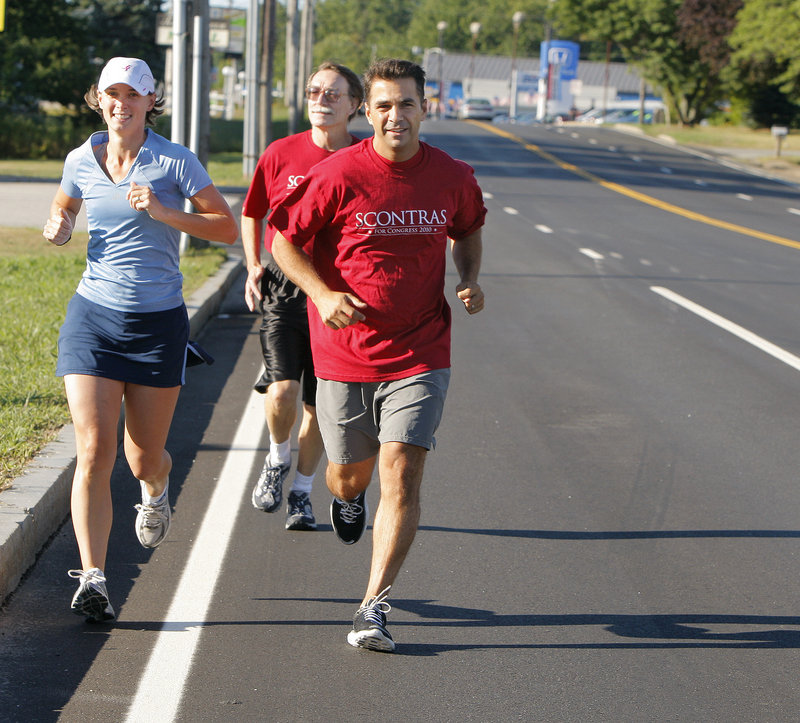 Dean Scontras, right, a Republican challenging Rep. Chellie Pingree for Maine's 1st District House seat, jogs with Kate Norfleet, left, and Allen Lifvergren on Route 1 in Saco.