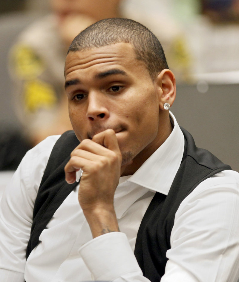 """Singer Chris Brown appears at a hearing Thursday in Los Angeles. A judge said he is doing a """"great job"""" completing the terms of his probation for his assault conviction."""