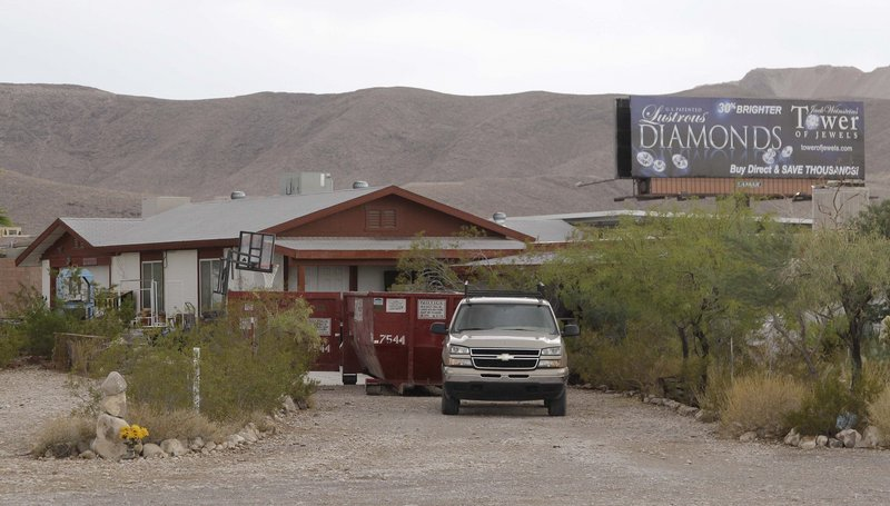 A pick-up truck and Dumpster are seen outside the home of Billie Jean James and her husband, Bill, on Thursday in Las Vegas.