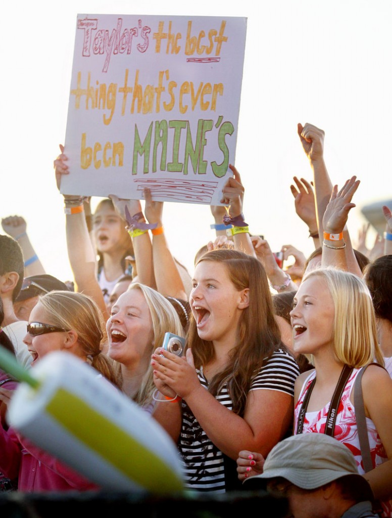 """Fans show their excitement Friday as Taylor Swift performs at St. Ann's Church in Kennebunkport after filming a live television special to introduce her latest music video, """"Mine."""""""