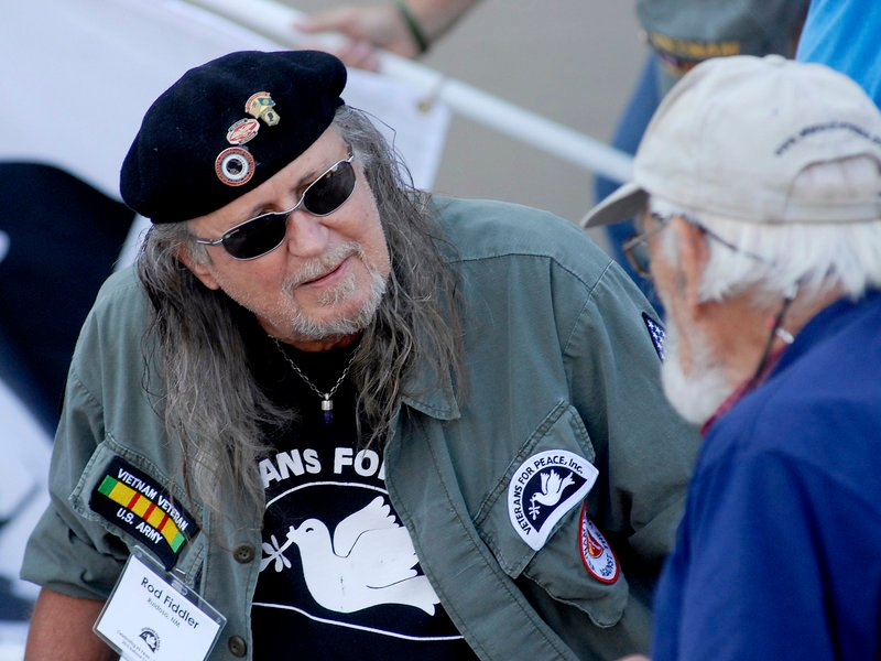 Rod Fiddler of Ruidoso, N.M., speaks with fellow veterans prior to the Veterans for Peace march and rally in Portland on Sunday.