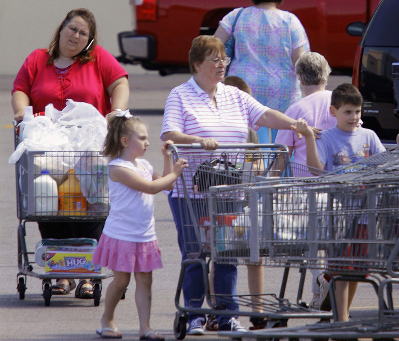 Shoppers leave a Walmart super center in Springfield, Ill., last week. Consumer spending rose 0.4 percent in July, the best showing since March following three months when spending was essentially flat. But without job growth, consumers are not expected to spend much more.