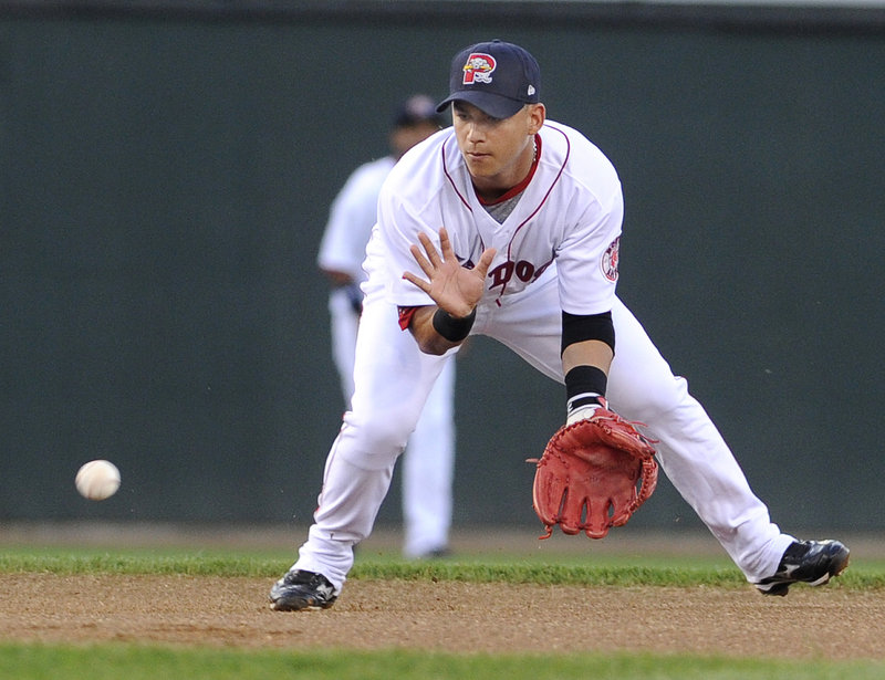 Jose Iglesias fields a ground ball for an out Monday night against the Binghamton Mets. Portland opened its season-ending, eight-game homestand with a 7-6 win.