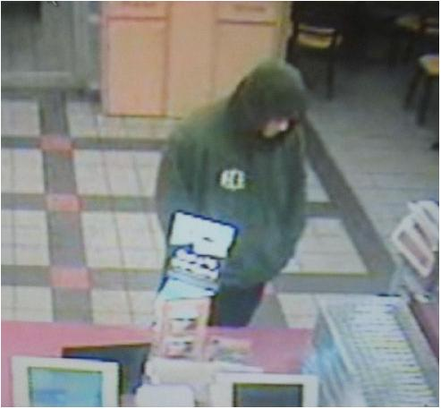 A robbery suspect appears in a segment of surveillance video at Dunkin' Donuts on Main Street in Westbrook.