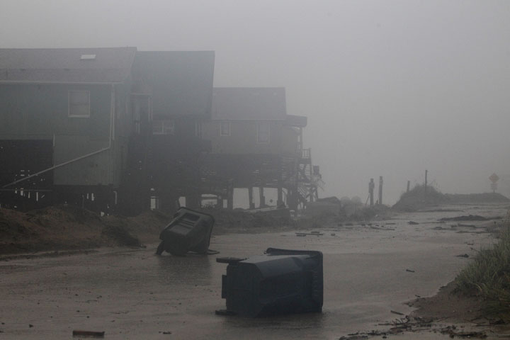 Debris covers the road along the beach in south Nags Head, N.C., today after wind and rain from Hurricane Earl passed through overnight.