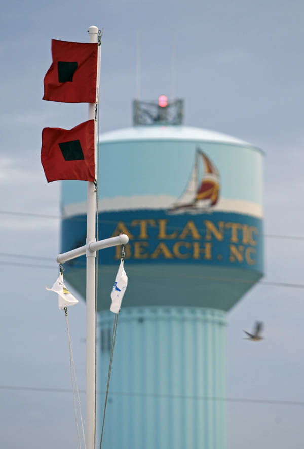 Hurricane flags blow in the wind in Atlantic Beach, N.C., today, as Hurricane Earl approaches.