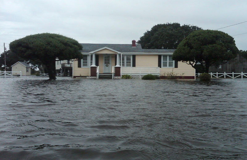 Flood waters surround a home after Hurricane Earl swept through Avon, N.C., today.