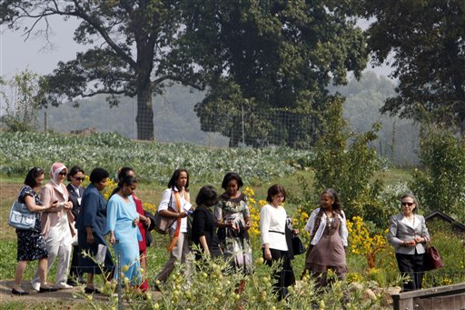 U.S. First lady Michelle Obama, center, walks with spouses of chiefs of state attending the U.N. General Assembly at the farm on Friday.