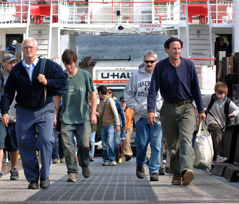 A crowd of people get off the Casco Bay Ferry, Machigonne, arriving in Portland from Peaks Island.