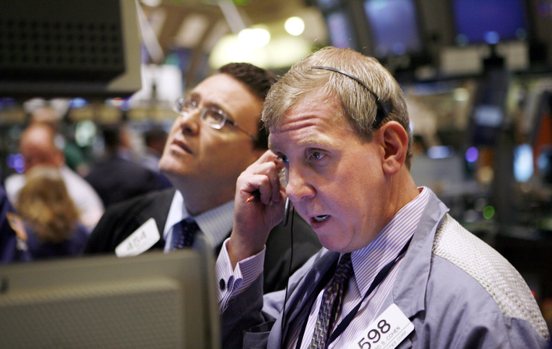 Traders and specialists work the trading floor of the New York Stock Exchange earlier this month. Retail customers have pulled back from the market since the