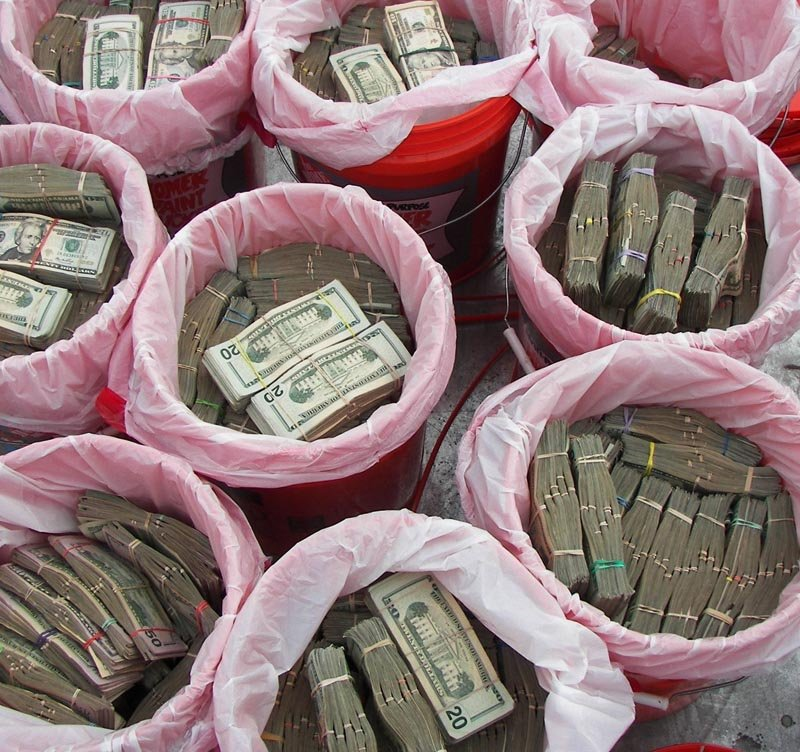 Some of the confiscated five-gallon Home Depot buckets filled with bundles of cash.
