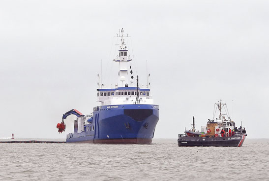 The U.S. Coast Guard vessel Shackle, right, passes by the Maine Responder during an oil spill cleanup drill in Portland Harbor.