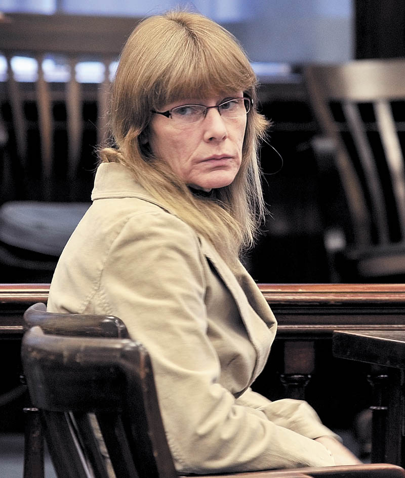 Karen McCaul looks back at family members of now deceased Richard Howe in Somerset Superior Court on Tuesday where she was found not criminally responsible by reason of insanity in the Christmas Eve 2009 stabbing death of Howe. McCaul was committed indefinitely to Riverview Psychiatric Center in Augusta.