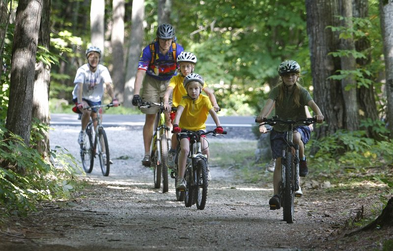 Brian Danz of the Greater Portland chapter of the New England Mountain Biking Association rides with beginning mountain bikers at Bradbury Mountain State Park in Pownal last Saturday.