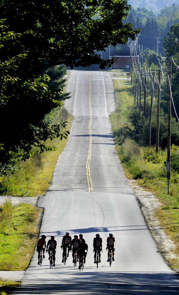 Maine Cycling Club members ride on a country road in the Auburn area that's part of the Dempsey Challenge route.