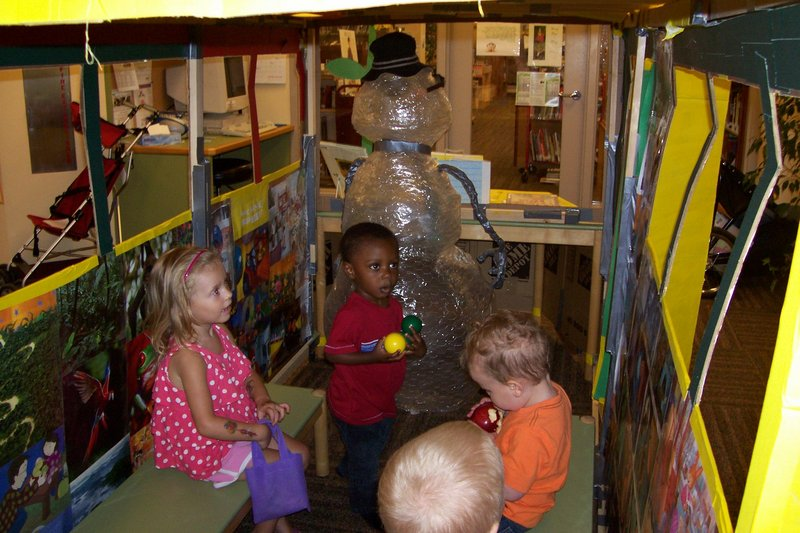 Youngsters enjoy the children-sized school bus that is part of the program at Walker Memorial Library in Westbrook. The bus driver is Dr. Snow, a snowman made by a teen assistant.